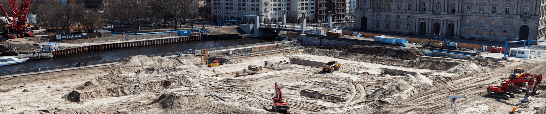 Construction site with equipment workers