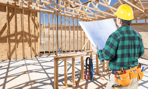 Remodeling contractor reviewing project job site